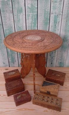Handmade wood-carved table and boxes