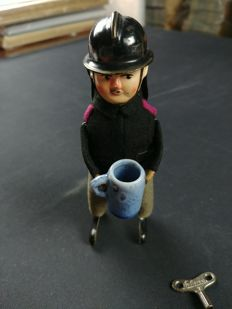 Schuco, Germany - Height: 13 cm - firefighter with mug 997/6, 1930s