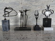 A lot with 4 bronze sculptures on marble pedestals, by Dutch artists