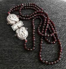 Long necklace of antique glass garnets and an antique silver 925 clasp from around 1880.