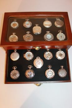 Display cabinet of 1980 with 18 exclusive silver-plated wind-up pocket watches