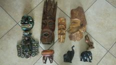 Four wooden masks, one wooden wall decoration piece, three wooden animals and a wooden ashtray