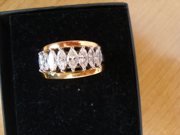 gold 18 kt ring, tested with touchstone with marquise cut diamonds, 8 stones, total between 1.10 to 1.20 ct, size 18