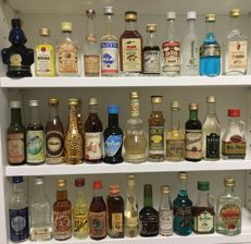 150 miniature bottles of various types of beverage
