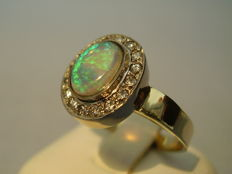 Antique 14 kt gold ring with solid opal (1.2 ct) and diamond entourage (0.35 ct)