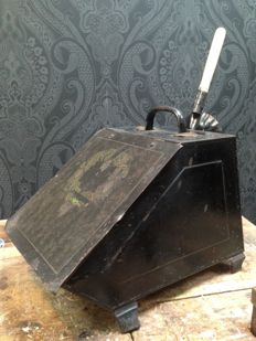 antique iron scuttle with a sink inner tray and coal shovel, decorated with pine cones and pine branches