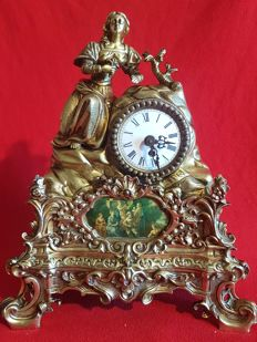 French windup clock in brass - early 20th century, with the figure of a woman carved in bronze