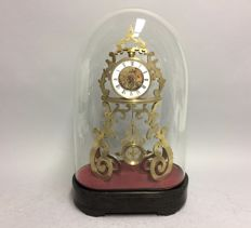 Antique French skeleton clock underneath glass bell jar with striking mechanism - France - around 1880