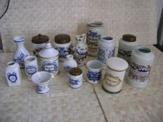 15 porcelain apothecary jars and 1 porcelain mortar