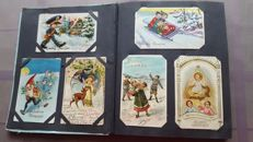 Album with only Christmas and happy new year postcards 145X including embossed cards and cards with gold imprint etc.