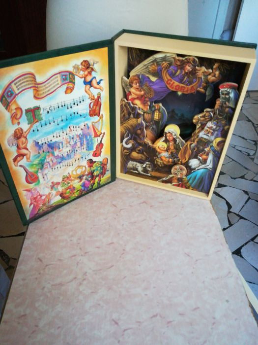 Book with music box and nativity scene