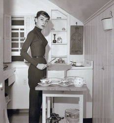 Earl Theisen (1903-1973) - Audrey Hepburn, in her kitchen, 1953