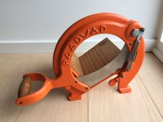 Wonderful vintage orange Raadvad bread slicer.