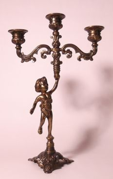 Candlestick carried by a putti