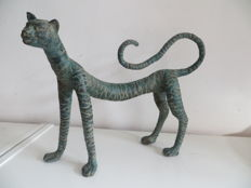 Bronze cat(like) creature with beautiful patina