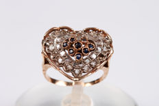 Heart-shaped ring in gold and silver with diamonds and sapphires