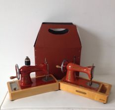 Two antique hand sewing machines USSR 1950