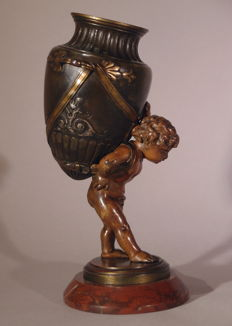 A patinated bronze statue of a putto carrying an amphora - France - end of nineteenth century