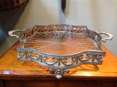 Metal tray with cut glass inside