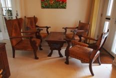 4 wooden chairs with leather upholstery and matching side table