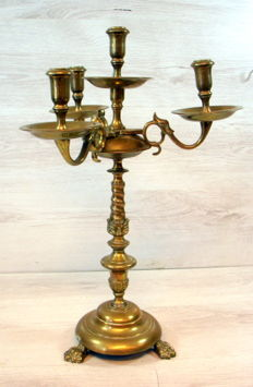 Heavy brass 4-light church candlestick with claw feet, the Netherlands, circa late 1800