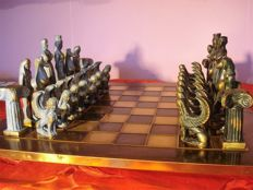 Beautiful old bronze carved chess pieces with under plate