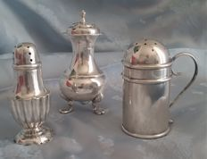 A lot of three Edwardian sterling silver pepper pots, Birmingham 1903 and 1905, Sheffield 1904