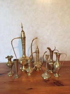 Collection of eastern, copper objects - vases, candle holder, jugs (8)