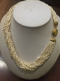 Nice necklace consisting of 13 strands of pearls with an 18 kt gold clasp