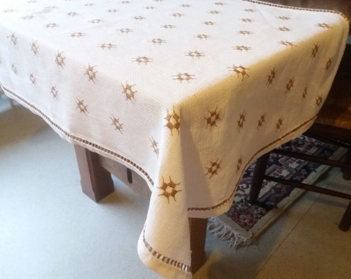 Completely hand embroidered tablecloth.