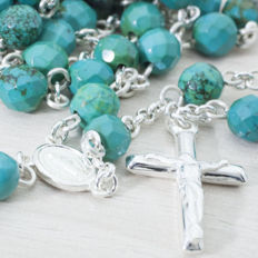 RSARY of faceted turquoise beads and sterling silver.