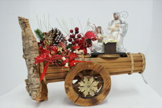 Nativity scene on large wooden cannon with decorations
