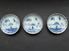 Three saucers, Chinese, with decoration of an ox - China - 18th century