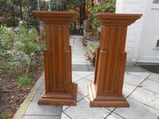 Two Neo-Gothic church pedestals in solid oak - Belgium - first half of the 20th century