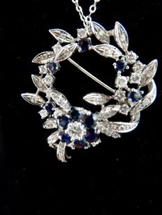 Beautiful gold brooch with 1.00 ct diamonds and 1.00 ct sapphires