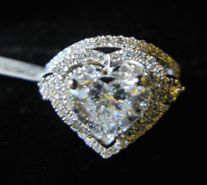 Platinum ring set with GIA 1.01 ct D SI2 - heart brilliant - 2 excellent cut- no fluorescence- and surrounding 0.55 ct D-F/VS2 diamonds- size #9, free resizing.