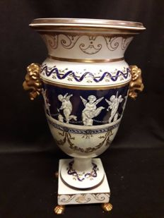 Porcelain vase decorated with classical motifs