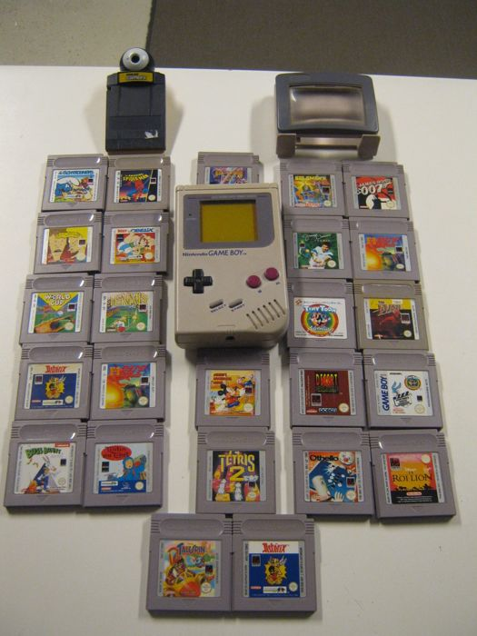 Gameboy Classic Gameboy with 25 games like: Spiderman, The Flash, Talespin, Lion King, othello and more