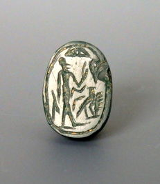 Phoenician green jasper scarab with figure & falcon to base - 16mm