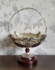 Large and richly decorated silver plated centrepiece with wooden base