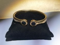 Bulgari 'Tubogas' bracelet with black onyx disk end-pieces - 18 kt gold - size L - 7.2 cm