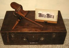 Wooden stereoscope with 3D pictures of the Dutch East Indies