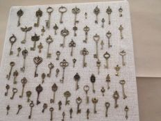 Collection of burnished metal keys of various sizes