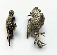 Two bird brooches in solid silver