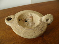Roman terracotta oil lamp decorated with a dog, length 100 mm