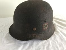 German helmet-M-35-WW2.  Double remains of decal