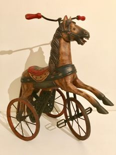 Large wrought iron wooden horse tricycle