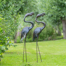 Two large flamingo sculptures