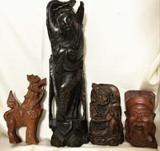 A set of four hand-carved wooden statues - Asia - 20th century