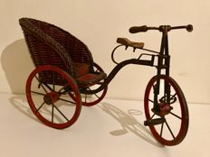 Wood and  wrought-iron tricycle.